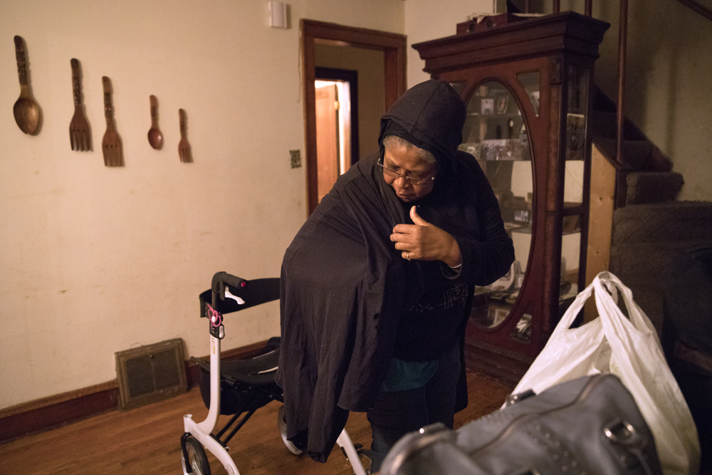 "71-year-old Kathyé Dawoudi prepares to leave her home for the day Tuesday, Jan. 3, 2017, in the Chatham neighborhood of Chicago. Dawoudi's 23-year-old grandson was shot and killed at his apartment building in 2015, but she said it and other factors don't stop her from going out each day. ""No matter how much pain I have,"" she said of emotions and her physical ailments, ""I keep moving...Movement and getting around and doing stuff makes me feel better."" (Erin Hooley/Chicago Tribune)"