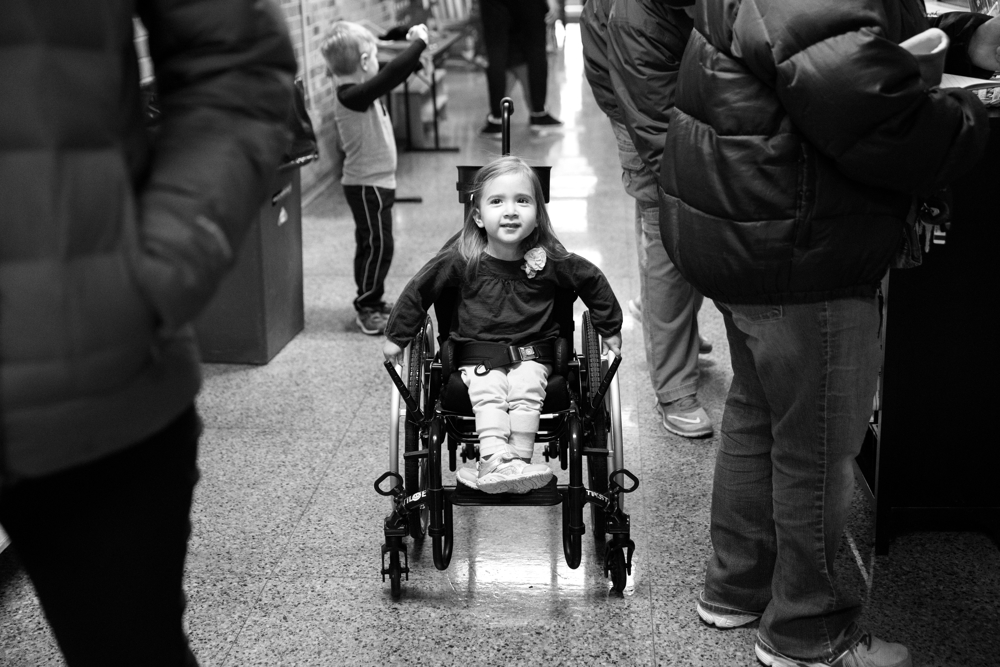3-year-old Dayna Dorencz-Cuervo pushes herself in her wheelchair as she heads to her classroom at Barbara Vick Early Childhood and Family Center Wednesday, Jan. 25, 2017, in the Kennedy Park neighborhood of Chicago. Dayna has spina bifida and several other health issues which require special care. She is currently unable to use her wheelchair at home, as the house is not wheelchair-friendly, but uses it at preschool. (Erin Hooley/Chicago Tribune)