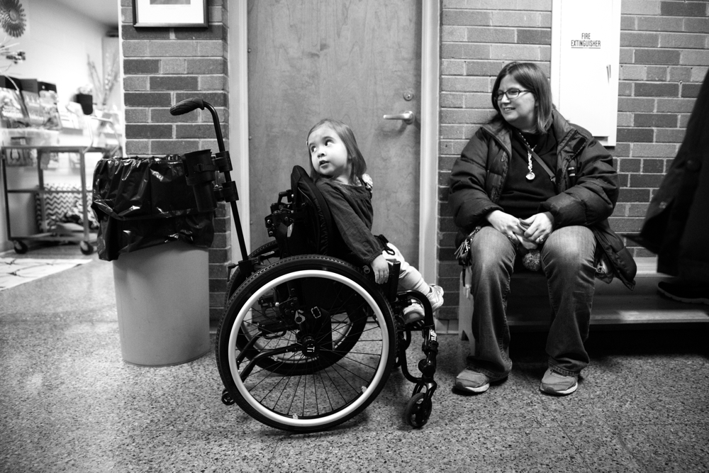 3-year-old Dayna Dorencz-Cuervo pushes herself in her wheelchair as she waits outside her classroom with her mother Kimberly at Barbara Vick Early Childhood and Family Center Wednesday, Jan. 25, 2017, in the Kennedy Park neighborhood of Chicago. Dayna has spina bifida and several other health issues which require special care. She usually gets around by crawling at home and uses a wheelchair when she goes to preschool. (Erin Hooley/Chicago Tribune)
