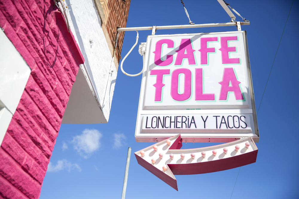 The sign for Cafe Tola hangs outside Wednesday, March 15, 2017, in the Avondale neighborhood of Chicago. (Erin Hooley/Chicago Tribune)
