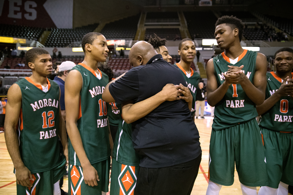 Morgan Park High School Head Coach Nick Irvin hugs Morgan Park High School forward Cam Irvin (4), his nephew, after their team defeated Fenwick High School 69-67 in overtime to win the Class 3A Championship game Saturday, March 18, 2017, at Carver Arena in Peoria, Ill. (Erin Hooley/Chicago Tribune)