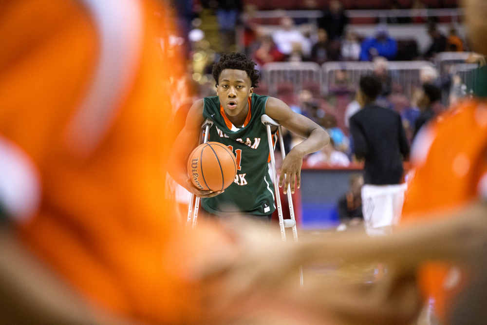 Morgan Park High School guard Ayo Dosunmu (11) hangs out with his teammates during warmup before the Morgan Park High School versus Fenwick High School 3A Championship game Saturday, March 18, 2017, at Carver Arena in Peoria, Ill. (Erin Hooley/Chicago Tribune)