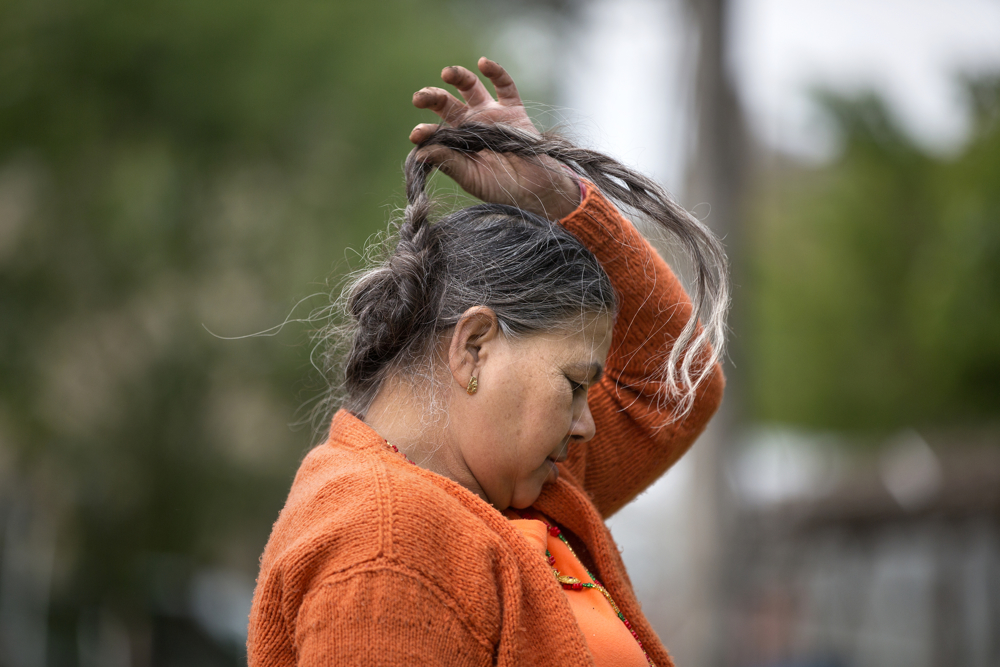 Renuka Pokhrel of Bhutan flips her braid around as she works in her family's garden plot in the Global Garden Refugee Training Farm Wednesday, May 24, 2017, in the Albany Park neighborhood of Chicago. About 100 families, including refugees from Bhutan, Myanmar and elsewhere, have plots in the community garden. (Erin Hooley/Chicago Tribune)