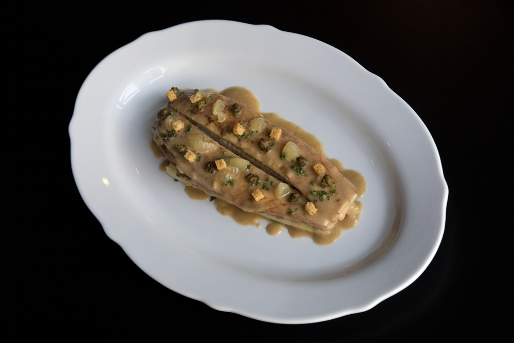 The dover sole a la meuniere is made with white asparagus, brown butter and lemon confit at Margeaux Brasserie at the Waldorf Astoria Thursday, June 6, 2017, in Chicago. (Erin Hooley/Chicago Tribune)