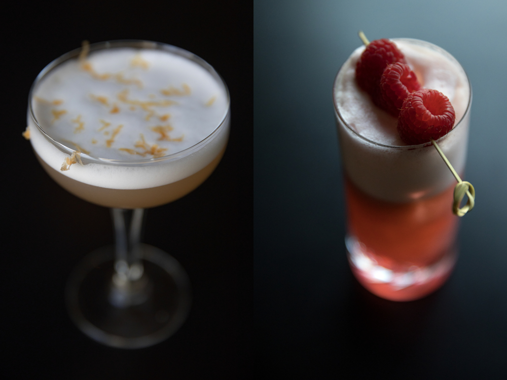 Left: The Green Hills of Africa cocktail is made with rum, Cocchi Americano rosa, lemon jasmine tea and grapefruit cordial, egg white and prosecco at Margeaux Brasserie at the Waldorf Astoria Thursday, June 6, 2017, in Chicago. Right: The Loveable Trixter cocktail is made with vodka, Aperol, raspberry, rhubarb, dry curacao, lemon, egg white and champagne at The Margeaux Brasserie at the Waldorf Astoria Thursday, June 6, 2017, in Chicago. (Erin Hooley/Chicago Tribune)