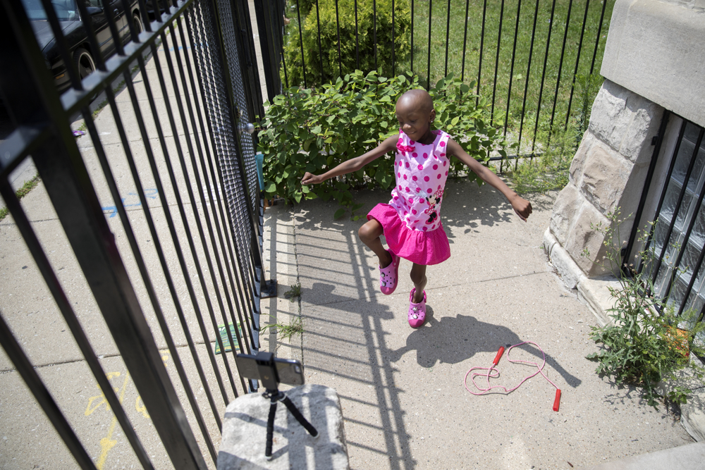 Jamela Anthony, 6, records herself dancing at her home Friday, July 7, 2017, in Chicago. Jamela has undergone extensive treatment for an aggressive tumor on her spinal cord that is now in remission. Her family has relied on Medicaid to cover costs. Tangela Watson, Jamela's mother, worries about how the Medicaid program might change if the Senate's Obamacare replacement bill becomes law. (Erin Hooley/Chicago Tribune)