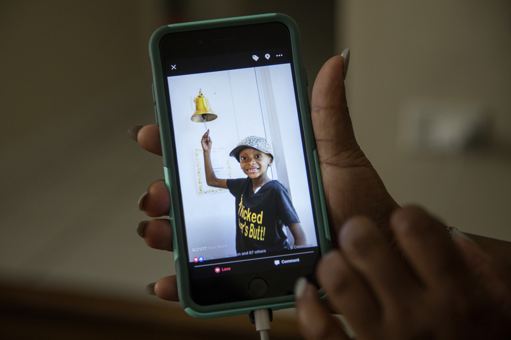 Tangela Watson holds a photo of her daughter Jamela Anthony, 6, on the day doctors declared her cancer in remission on June 21, at their home Friday, July 7, 2017, in Chicago. Jamela has undergone extensive treatment for an aggressive tumor on her spinal cord that is now in remission. Her family has relied on Medicaid to cover costs. Watson worries about how the Medicaid program might change if the Senate's Obamacare replacement bill becomes law. (Erin Hooley/Chicago Tribune)