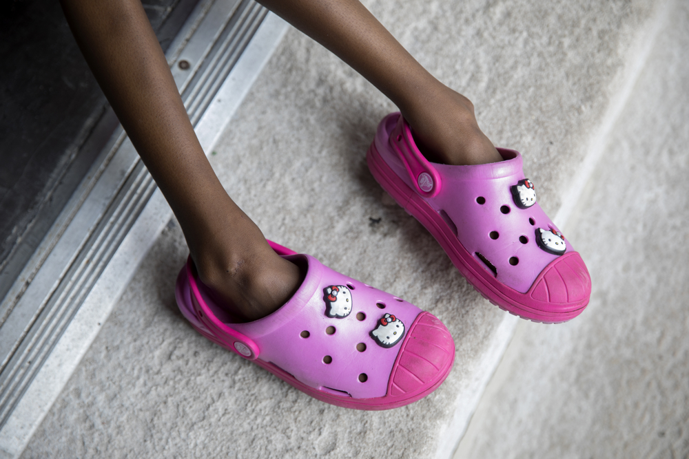 Jamela Anthony, 6, wears Hello Kitty shoes as she plays at her home Friday, July 7, 2017, in Chicago. Jamela Anthony, 6, walks up the stairs to her home Friday, July 7, 2017, in Chicago. Jamela has undergone extensive treatment for an aggressive tumor on her spinal cord that is now in remission. Her family has relied on Medicaid to cover costs. Tangela Watson, Jamela's mother, worries about how the Medicaid program might change if the Senate's Obamacare replacement bill becomes law. (Erin Hooley/Chicago Tribune)