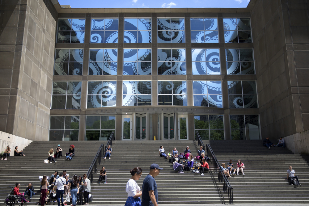 "Octopus tentacles decorate a front window of the Museum of Contemporary Art ahead of the opening of the Takashi Murakami exhibit, ""The Octopus Eats Its Own Leg,"" Wednesday, May 31, 2017, in Chicago. The exhibit officially opens June 6 and runs through September 24. (Erin Hooley/Chicago Tribune)"