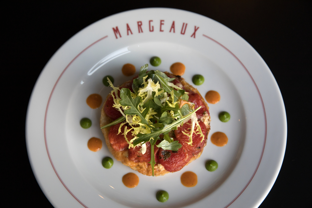 The tomato tatin is made with carmelized onion, marinated buratta and warm tomato vinaigrette at Margeaux Brasserie at the Waldorf Astoria Thursday, June 6, 2017, in Chicago. (Erin Hooley/Chicago Tribune)