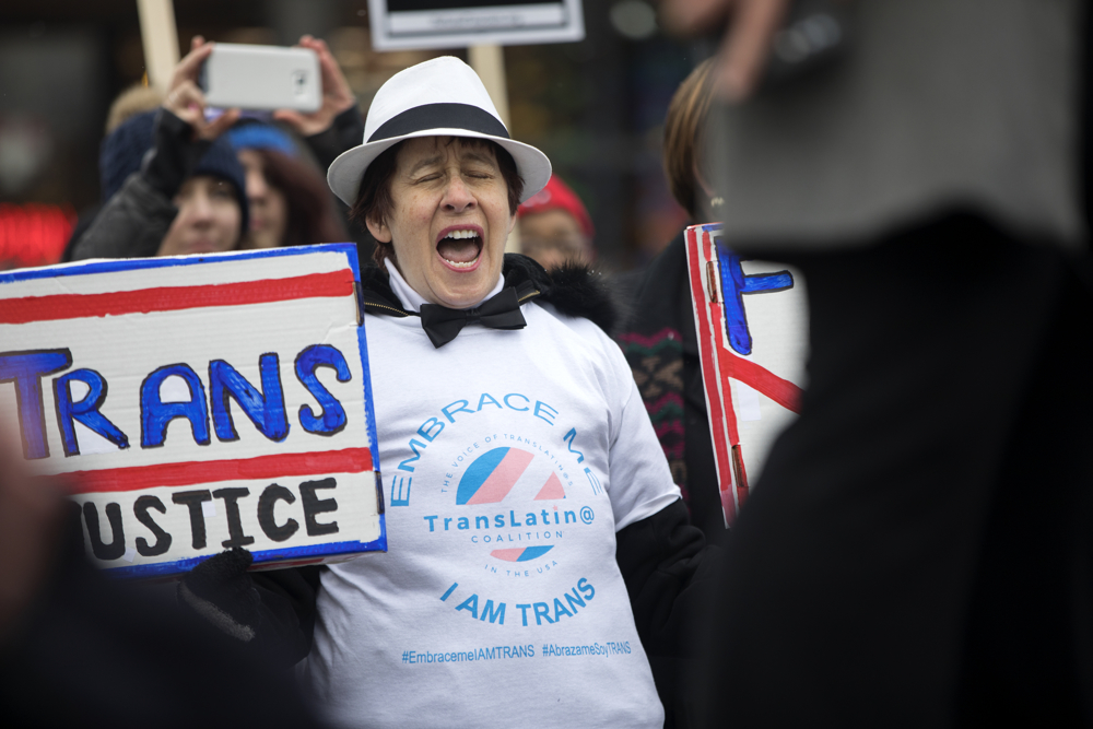 Virginia Boyle cheers at a rally in support of transgender rights Saturday, Feb. 25, 2017, in the Boystown neighborhood of Chicago. The rally was organized to protest the move by the Trump administration to roll back federal protections for transgender students in public schools. (Erin Hooley/Chicago Tribune)