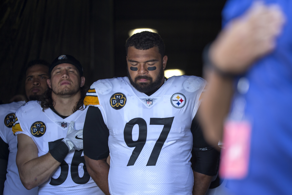 Pittsburgh Steelers defensive end Cameron Heyward, center, and other players remain in the tunnel for the National Anthem before the game against the Chicago Bears Sunday, Sept. 24, 2017, at Solider Field in Chicago. Bears players stood along their sideline, most of them with their arms interlocked in a show of unity. The entire Steelers team, with the exception of offensive tackle Alejandro Villanueva, remained in their locker room during the anthem. Villanueva, who served in the Army, stood near the northeast corner of the field with his hand over his heart. That was the response at Soldier Field to the firestorm that has swept through the sports world this weekend in the aftermath of sharp comments made by President Donald Trump, who blasted players who have chosen to engage in peaceful demonstration during the National Anthem. (Erin Hooley/Chicago Tribune)