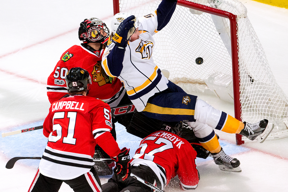 Nashville Predators center Ryan Johansen, right, falls backward over Chicago Blackhawks defenseman Trevor van Riemsdyk, bottom, as he scores a fourth goal for the Predators on Blackhawks goalie Corey Crawford during the third period of Game 2 of the Western Conference quarterfinals between game Saturday, April 15, 2017, at the United Center in Chicago. The Predators shut out the Blackhawks for the second time in a row 5-0 and ultimately swept the Chicago team in the best of seven series. (Erin Hooley/Chicago Tribune)