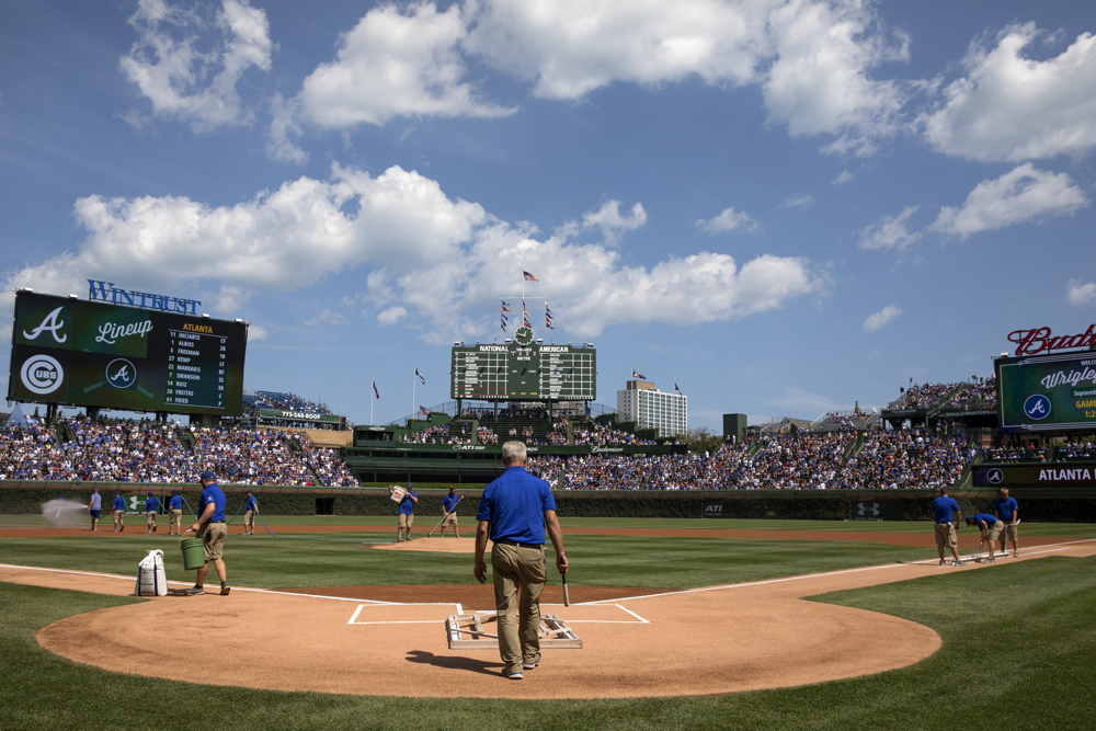 Workers prepare the field before the Chicago Cubs versus Atlanta Braves game Sunday, Sept. 3, 2017, at Wrigley Field in Chicago. (Erin Hooley/Chicago Tribune)