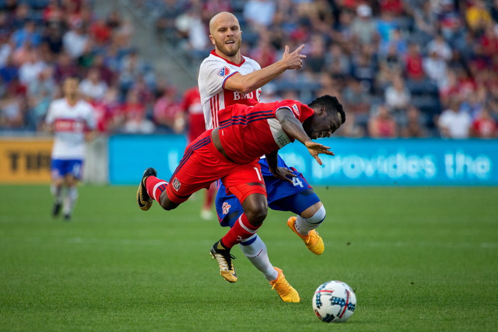 Toronto FC midfielder Michael Bradley (4) fouls Chicago Fire forward David Accam (11) during the first half of the Chicago Fire match against Toronto FC Saturday, August 19, 2017, at Toyota Park in Bridgeview, Ill. The score was 1-0 Toronto at the end of the half. (Erin Hooley/Chicago Tribune)
