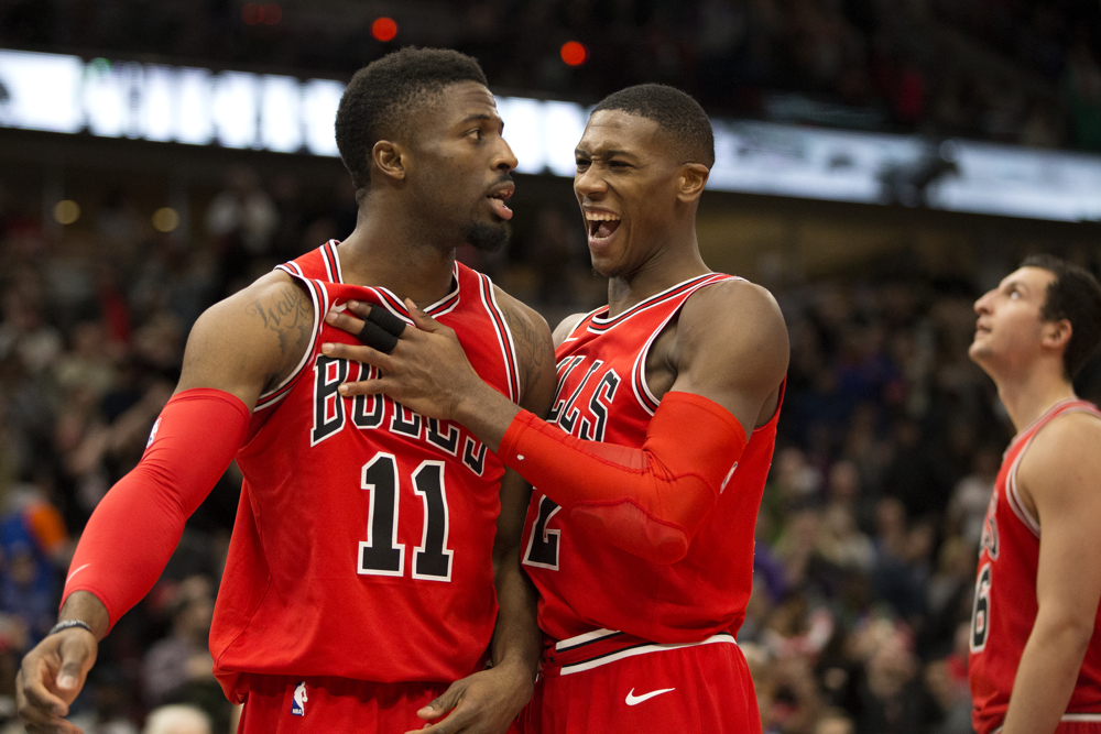 Chicago Bulls guard David Nwaba (11) and Chicago Bulls guard Jerian Grant (2) celebrate their 104-102. win over the New York Knicks Saturday Dec. 9, 2017, at the United Center in Chicago. (Erin Hooley/Chicago Tribune)