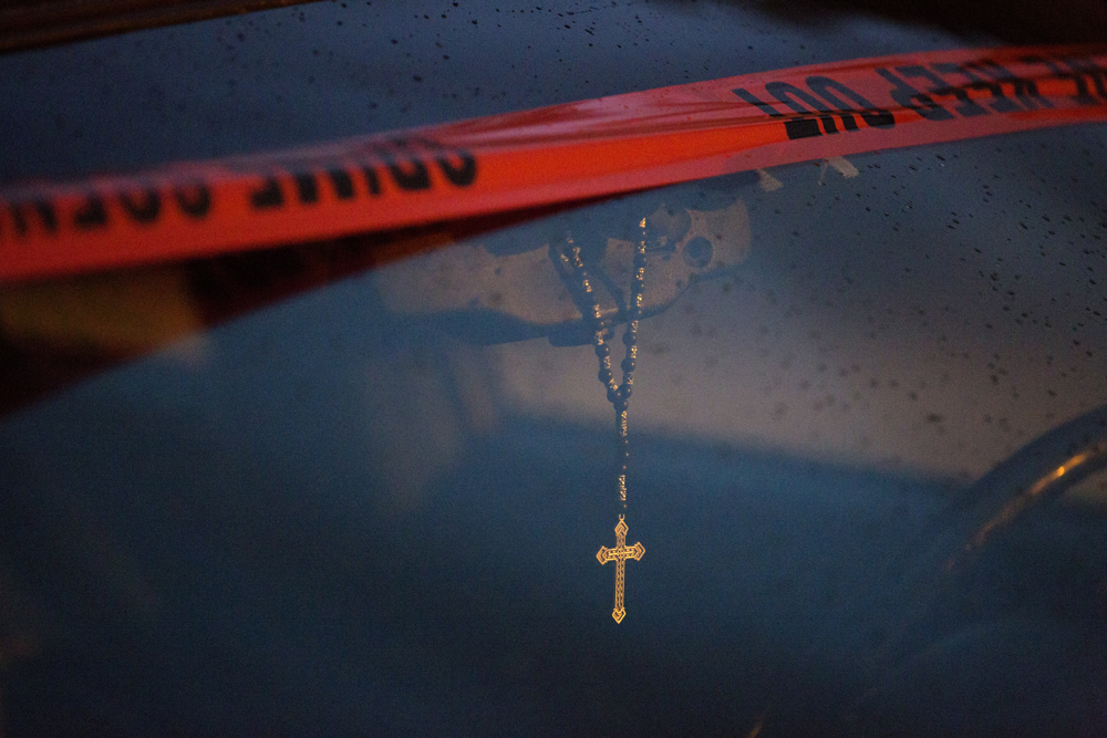 Rain falls on a car with police tape at the scene where 32-year-old Dario Balderrama was shot multiple times and killed in the 4800 block of South Racine Avenue Saturday, June 17, 2017, in the Back of Yards neighborhood of Chicago. About an hour later, two men and one woman were shot and taken to area hospitals less than a mile away on 44th Street. Both incidents involved rifles. (Erin Hooley/Chicago Tribune)