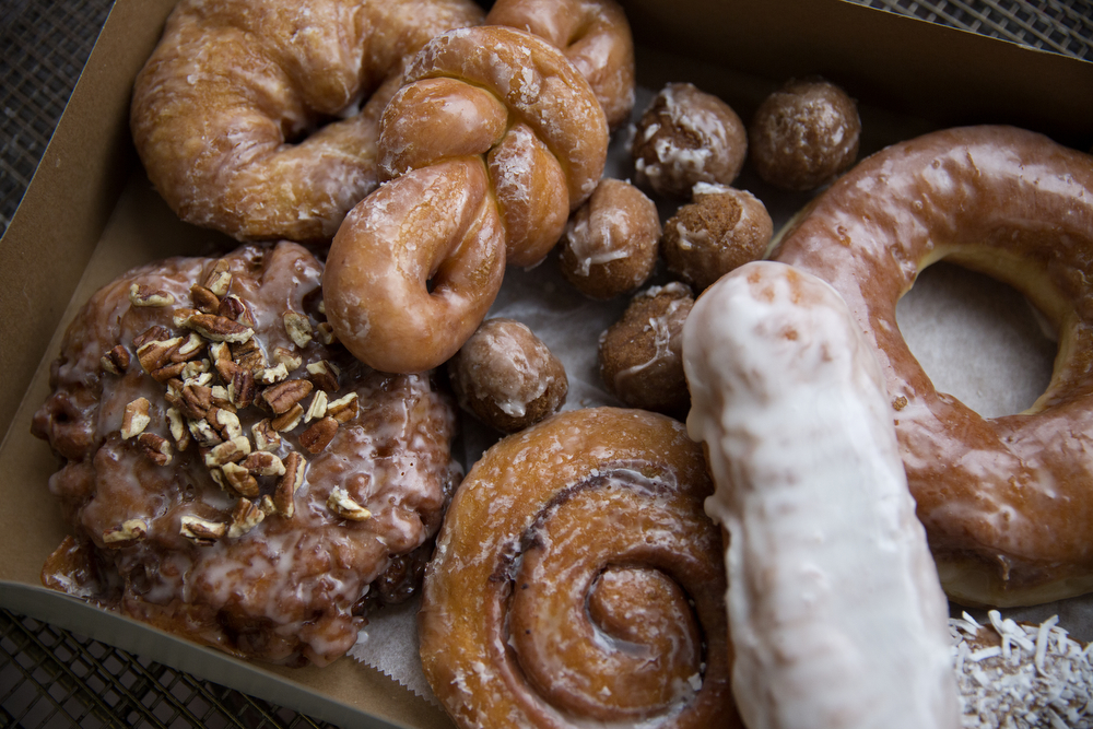 A variety of donuts and other pastries are arranged in a box Tuesday, March 6, 2018, at Old Fashioned Donuts in the Roseland neighborhood of Chicago. (Erin Hooley/Chicago Tribune)