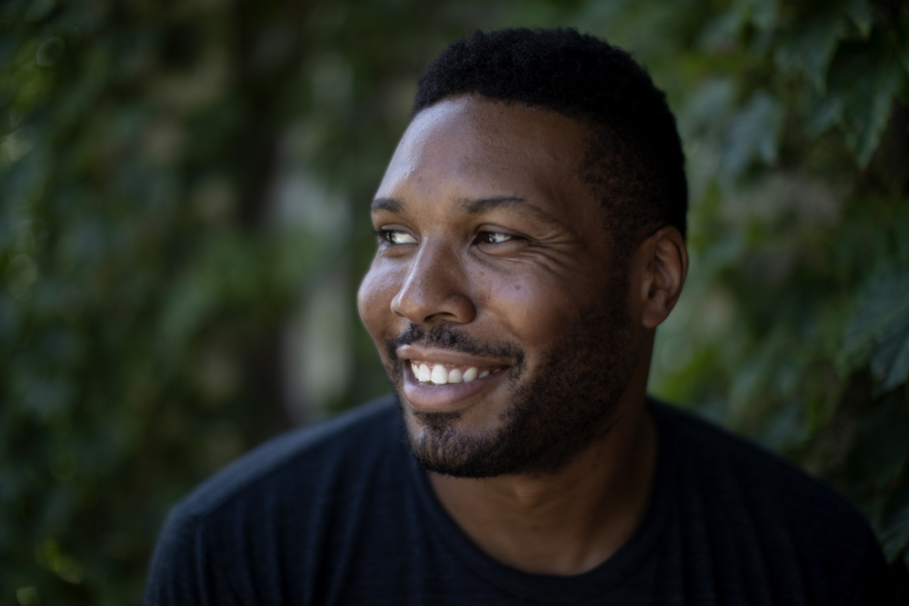 Geno Walker poses for a portrait at his home Thursday, Aug. 16, 2018, in the Woodlawn neighborhood of Chicago. Walker, of Timeline Theatre, is one of the Chicago Tribune's Hot New Faces of Chicago Theater 2018. (Erin Hooley/Chicago Tribune)