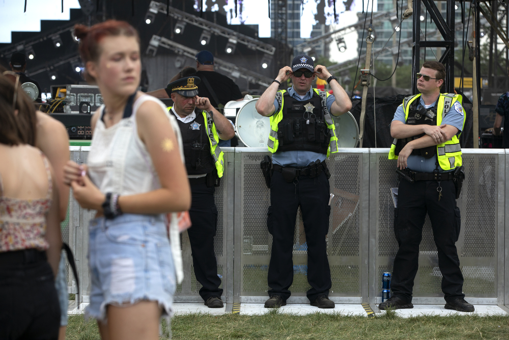 Chicago police officers stand by at Lollapalooza Thursday, August 2, 2018, at Grant Park in Chicago. (Erin Hooley/Chicago Tribune)