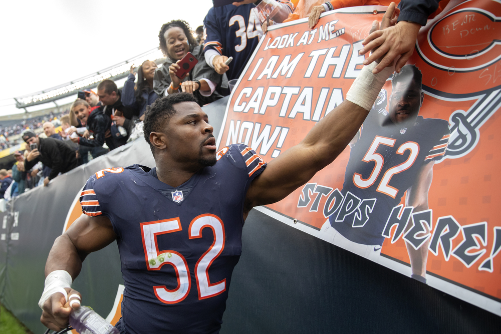 Chicago Bears linebacker Khalil Mack (52) high-fives fans after the Chicago Bears 48-10 win over the Tampa Bay Buccaneers game Sunday, Sept. 30, 2018, at Soldier Field in Chicago. (Erin Hooley/Chicago Tribune)