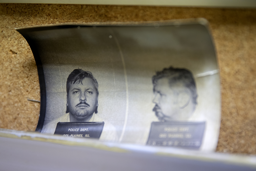 Mugshots of John Wayne Gacy taken on Dec. 21, 1978, at the Des Plaines Police Department, are attached to a bulletin board at Cook County warehouse Wednesday, Nov. 21, 2018, in Chicago. (Erin Hooley/Chicago Tribune)