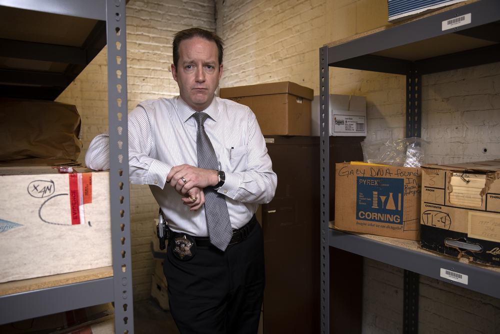 Detective Sgt. Jason Moran of the Cook County Sheriff's Office stands in the room where evidence from the serial killer John Wayne Gacy murders is kept Wednesday, Dec. 5, 2018, at the Cook County Warehouse in Chicago. Since the case reopened in 2010, Moran has helped identify two previously unknown victims, William George Bundy and James Byron Haakenson. Of the 33 total murders, six still remain unidentified. (Erin Hooley/Chicago Tribune)