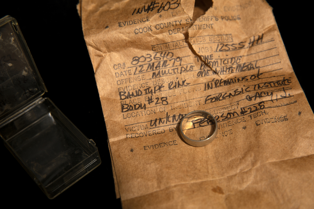 A simple ring recovered from the left ring finger of an unidentified victim of the serial killer John Wayne Gacy is seen Tuesday, Dec. 4, 2018, at the Cook County Warehouse in Chicago. (Erin Hooley/Chicago Tribune)