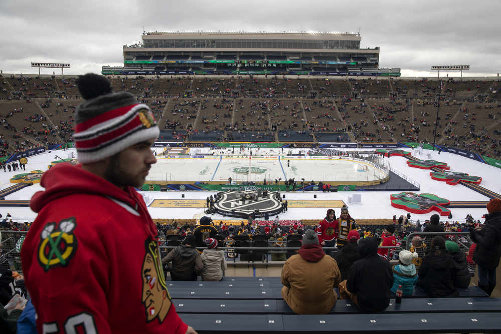 Fans gather in the stands before the Winter Classic outdoor hockey game between the Chicago Blackhawks and Boston Bruins Tuesday, Jan. 1, 2019, at Notre Dame Stadium in South Bend, Ind. (Erin Hooley/Chicago Tribune)