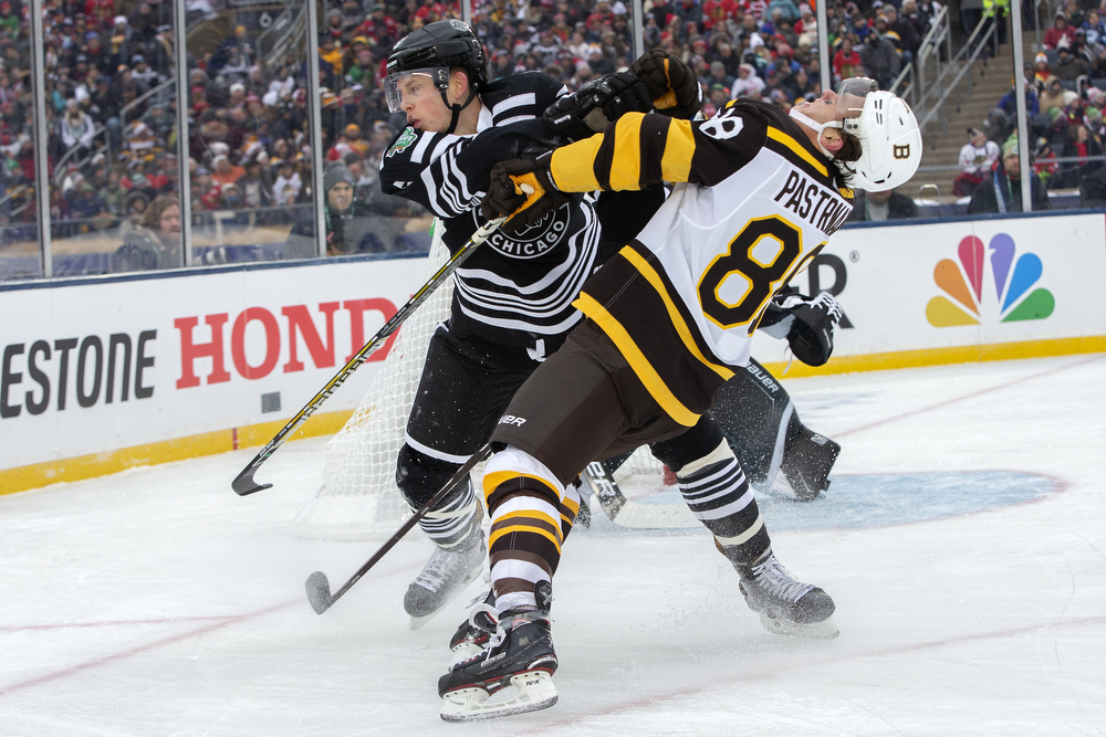 Chicago Blackhawks defenseman Connor Murphy (5) shoves Boston Bruins right wing David Pastrnak (88) during the second period of the Winter Classic outdoor hockey game between the Chicago Blackhawks and Boston Bruins Tuesday, Jan. 1, 2019, at Notre Dame Stadium in South Bend, Ind. (Erin Hooley/Chicago Tribune)