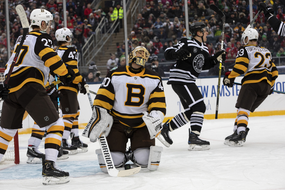 Chicago Blackhawks left wing Brendan Perlini (11) scores on Boston Bruins goaltender Tuukka Rask (40) during the first period of the Winter Classic outdoor hockey game between the Chicago Blackhawks and Boston Bruins Tuesday, Jan. 1, 2019, at Notre Dame Stadium in South Bend, Ind. (Erin Hooley/Chicago Tribune)