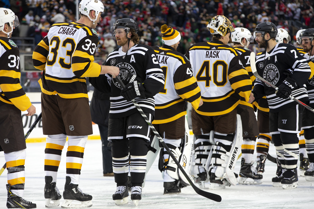 Chicago Blackhawks defenseman Duncan Keith (2) greets Boston Bruins defenseman Zdeno Chara (33) as the teams shake hands after their loss to the Boston Bruins in the Winter Classic outdoor hockey game Tuesday, Jan. 1, 2019, at Notre Dame Stadium in South Bend, Ind. Boston won the game 4-2. (Erin Hooley/Chicago Tribune)