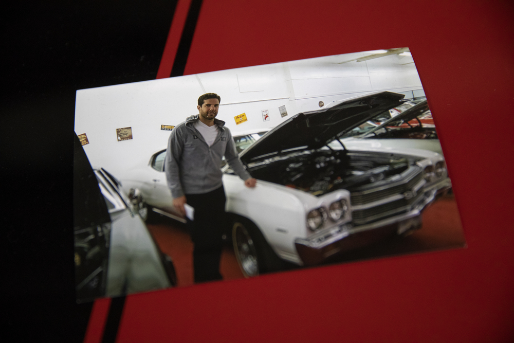 """A photo shows Chicago Blackhawks goaltender Corey Crawford with the """"before"""" version of the 1970 Chevy Chevelle SS he restored with help from his friends at Nortown Auto LLC Monday, Nov. 19, 2018, in Chicago. He donated the car to the Chicago Blackhawks Foundation and fans can purchase raffle tickets at Blackhawks home games or online to enter the charity drawing for the car held February 18 2019. (Erin Hooley/Chicago Tribune)"""