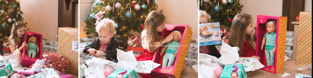 little girl opening doll at Christmas