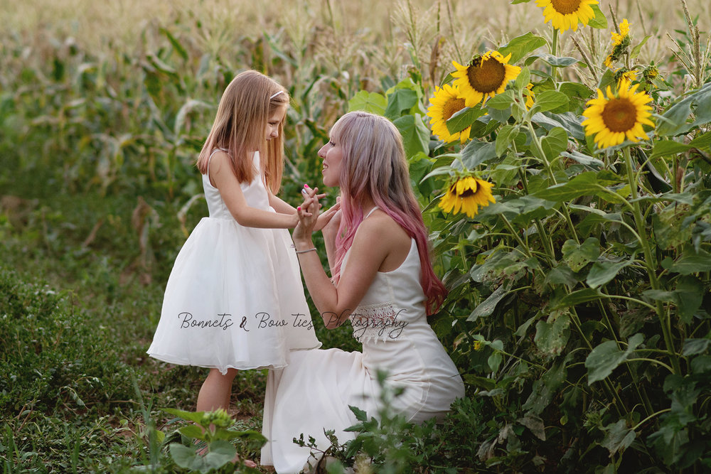 mother and daughter photo shoot in sunflowers at Lehman's feed store