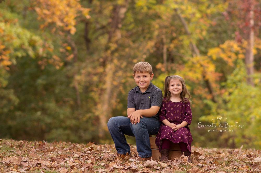 girl and boy sitting pose.jpg