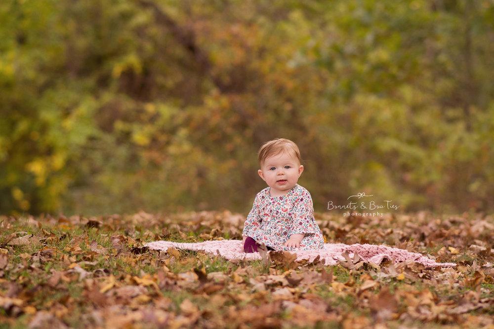 baby girl sitting in leaves session.jpg