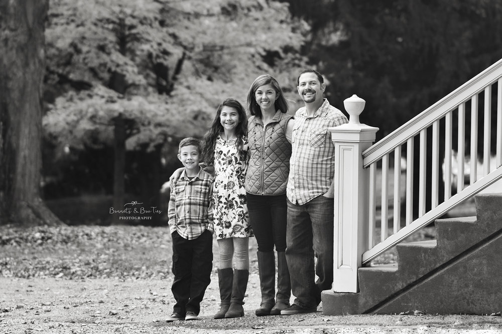 black and white portrait of family in the fall.jpg