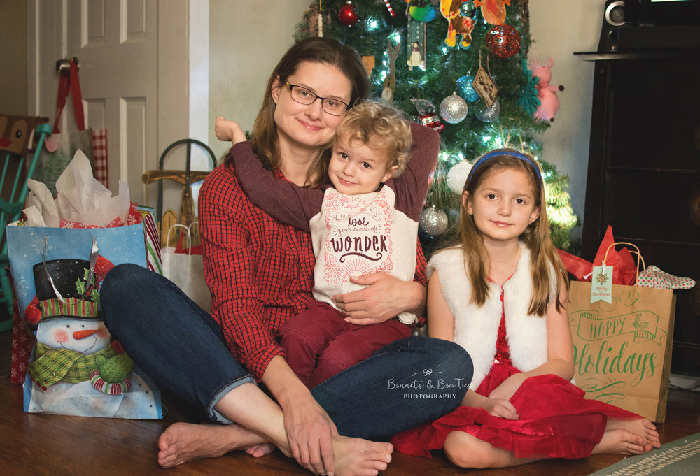mother and children posing in front of christmas tree.jpg