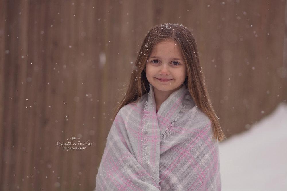 girl posing in snow.jpg