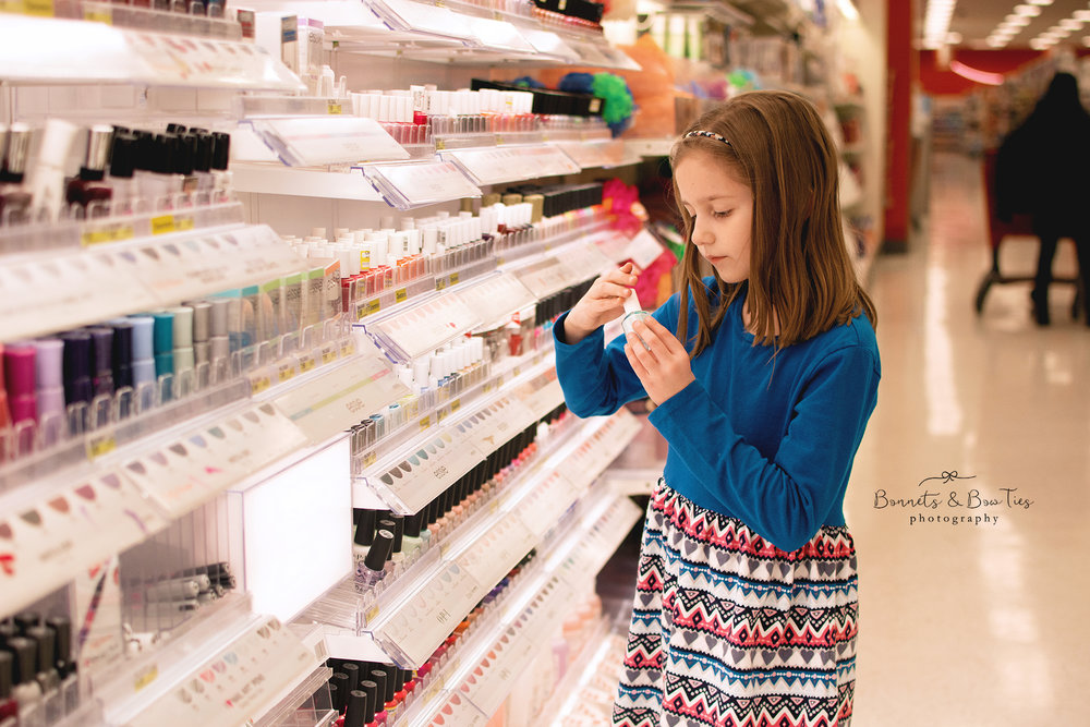 girl buying nail polish for photo shoot in york pa.jpg