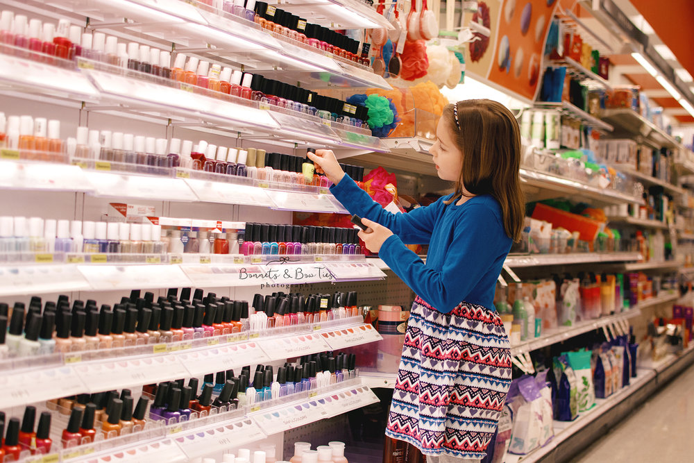 girl looking a nail polish at Target.jpg