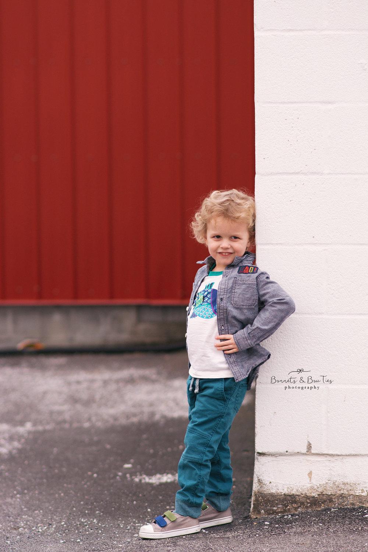 boy modeling against white wall.jpg