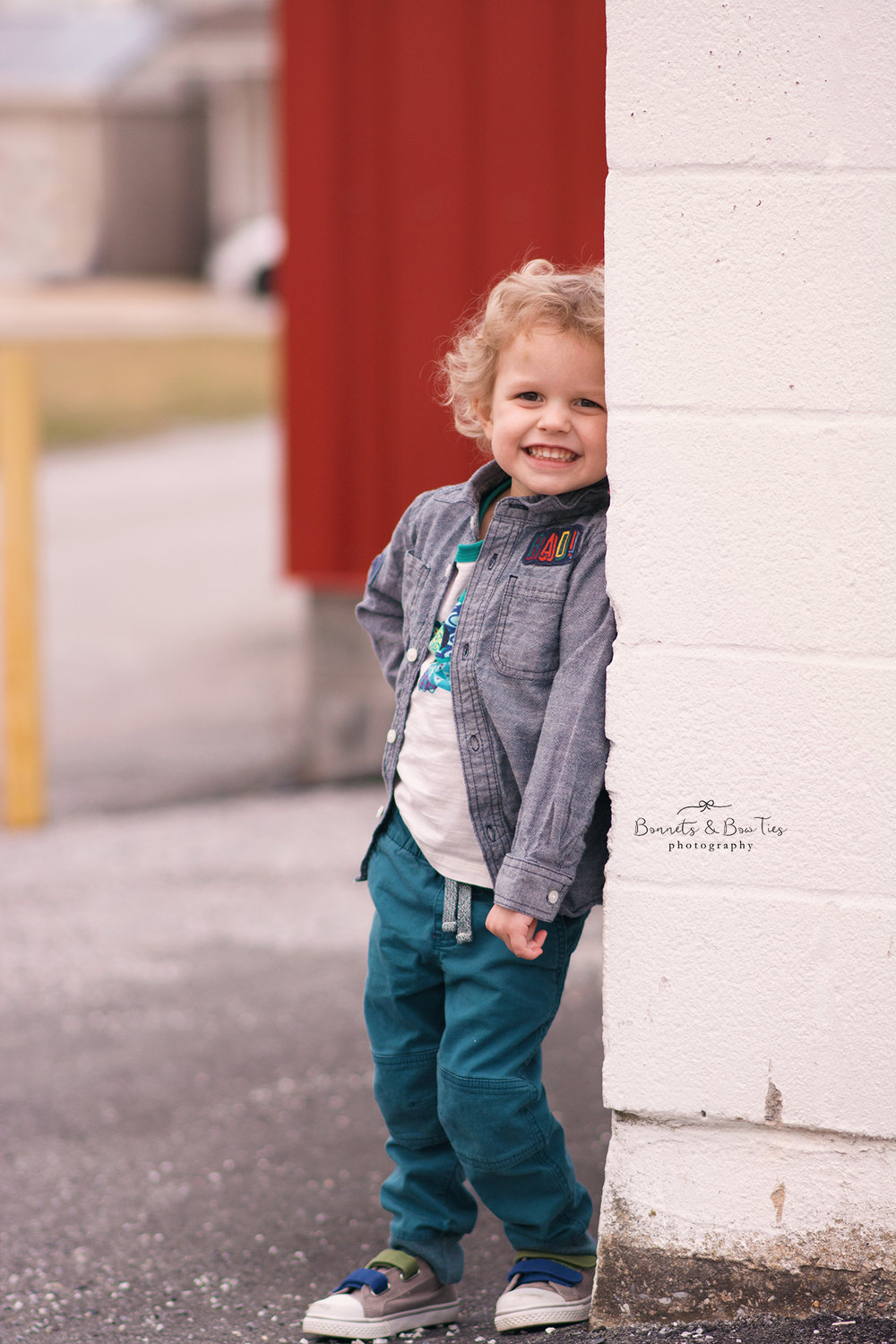 boy standing near red wall.jpg