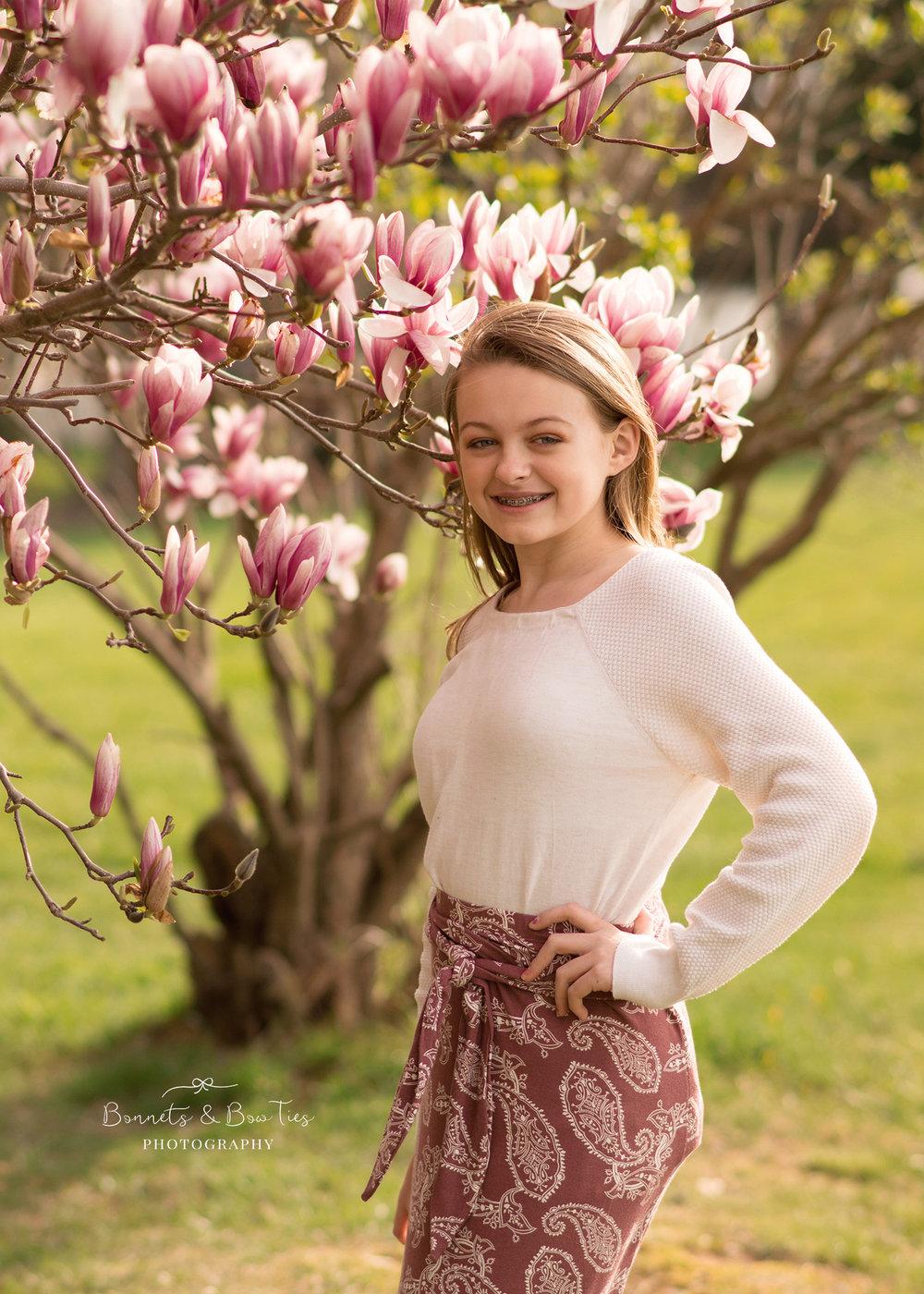 girl posing near pink flowers.jpg