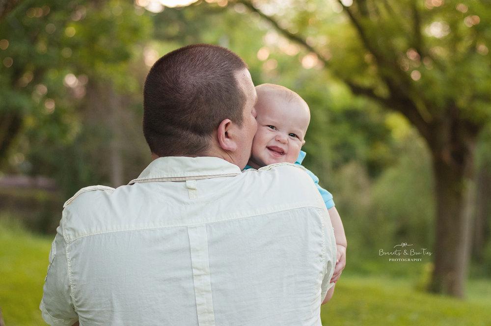 Daddy kissing son.jpg