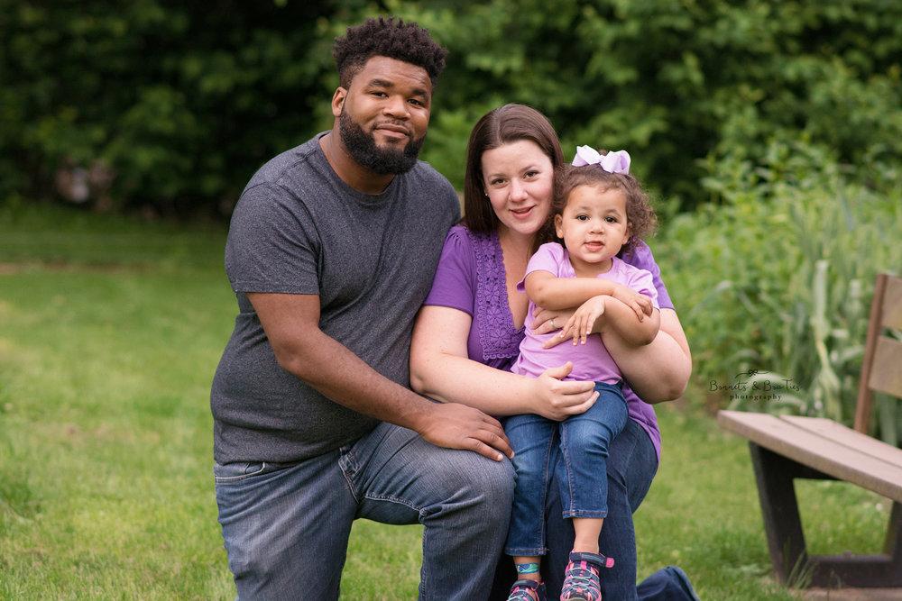 Mom dad and daughter pose for photo at john rudy park.jpg