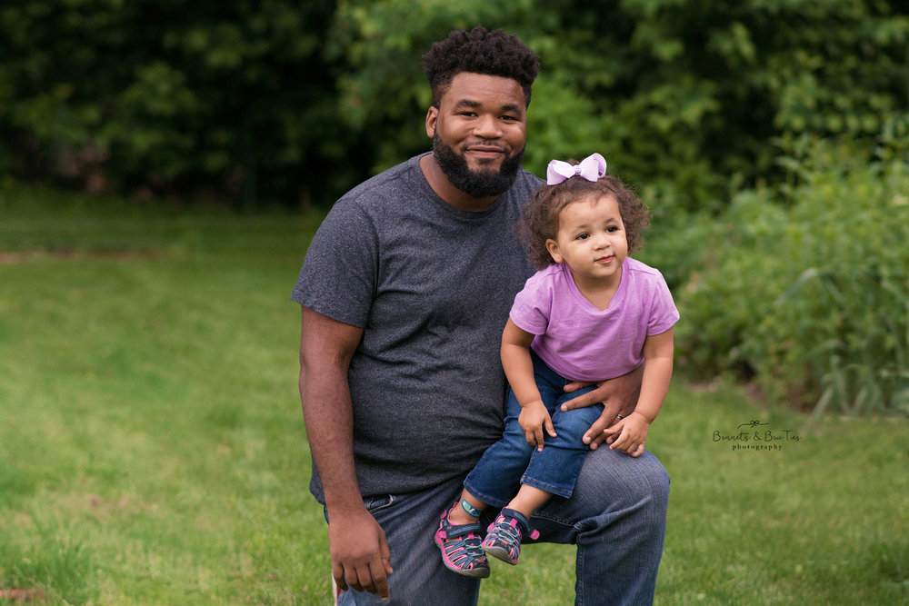 dad and daughter pose for family portraits.jpg
