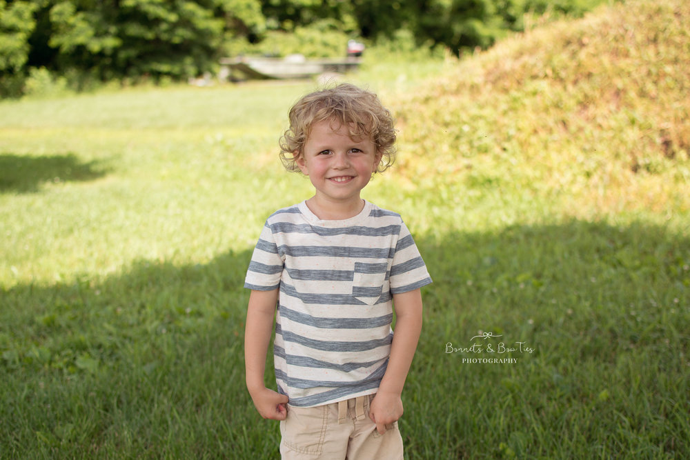boy wearing blue and white striped shirt.jpg