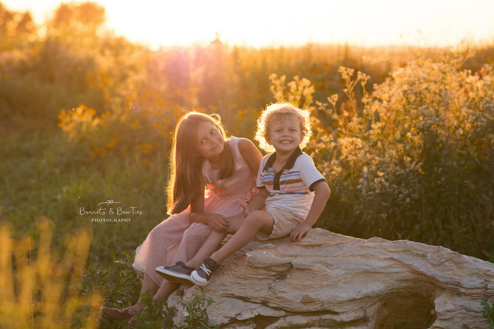 two kids sitting on rock.jpg